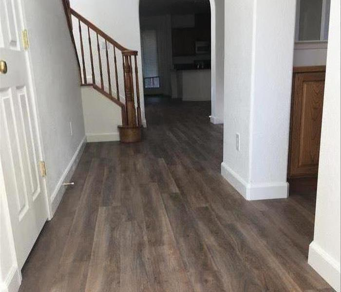residential hallway with new flooring installed