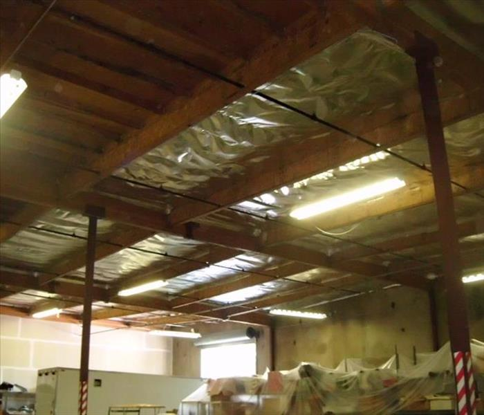 Storm damage in a warehouse ceiling